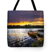 Boat on lake at sunset Tote Bag by Elena Elisseeva