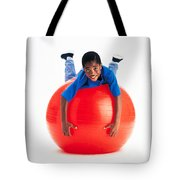 Boy Balancing On Exercise Ball Tote Bag by Ron Nickel