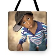 Boy Wearing Over Sized Hat Riding Bike Tote Bag by Ron Nickel