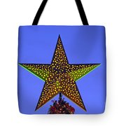 Christmas star during dusk time Tote Bag by George Atsametakis