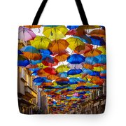 Colorful Floating Umbrellas Tote Bag by Marco Oliveira