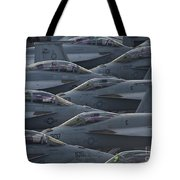 Fa18 Super Hornets Sit On The Flight Deck Of The Aircraft Carrier Uss Enterprise  Tote Bag by Paul Fearn