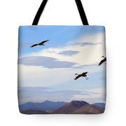 Flight Of The Sandhill Cranes Tote Bag by Mike  Dawson