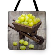 Fresh Green Grapes In A Wheelbarrow Tote Bag by Aged Pixel