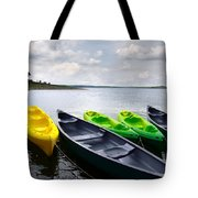 Green and yellow kayaks Tote Bag by Carlos Caetano