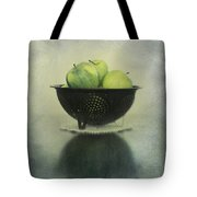 Green Apples In An Old Enamel Colander Tote Bag by Priska Wettstein