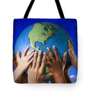 Hands On A Globe Tote Bag by Don Hammond
