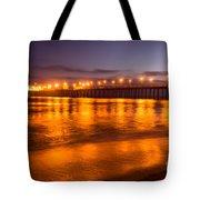 Huntington Beach Pier At Night Tote Bag by Paul Velgos