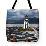 Lighthouse in Lake Dillon Tote Bag by Juli Scalzi