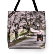 Man In Wheelchair Under Cherry Blossoms Tote Bag by Dan Friend