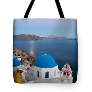 Moon over blue domed church in Oia Santorini Greece Tote Bag by Matteo Colombo