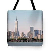 One World Trade Center And Ellis Island 2 Tote Bag by Susan Candelario