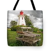 Prince Edward Island Lighthouse With Lobster Traps Tote Bag by Edward Fielding
