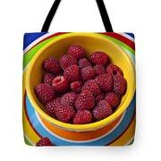 Raspberries In Yellow Bowl On Plate Tote Bag by Garry Gay