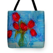 Red Tulips With Blue Background Tote Bag by Patricia Awapara