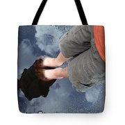 Reflection Of Boy In A Puddle Of Water Tote Bag by Matthias Hauser
