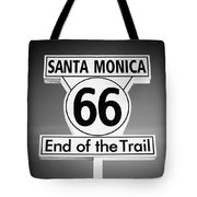 Route 66 Sign In Santa Monica In Black And White Tote Bag by Paul Velgos