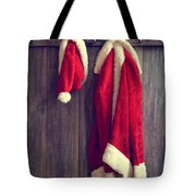 Santa's Hat And Coat Tote Bag by Amanda And Christopher Elwell