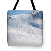 Ski Tracks In The Snow On A Mountain Tote Bag by Keith Levit