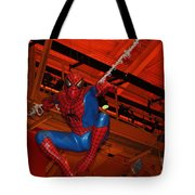 Spiderman Swinging Through The Air Tote Bag by John Telfer