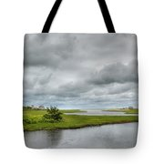 Sunshine And Heavy Clouds Over Dennisport Tote Bag by Michelle Wiarda