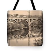 The Schuylkill River And Manayunk Bridge In Sepia Tote Bag by Bill Cannon