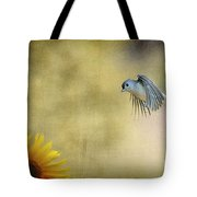 Tufted Titmouse Flying Over Flower Tote Bag by Dan Friend