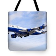 United Airlines Boeing 747 Airplane Flying Tote Bag by Paul Velgos
