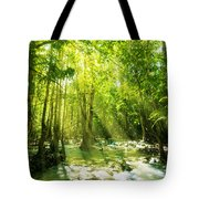 Waterfall In Rainforest Tote Bag by Atiketta Sangasaeng