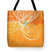 White Flower On Orange Tote Bag by Linda Woods