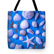 White Sea Shells On Blue Board Tote Bag by Garry Gay