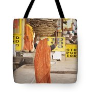 Woman Carrying Cow Dung In Basket On Tote Bag by Paul Miles