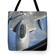 An F-22 Raptor Receives Fuel Tote Bag by Stocktrek Images