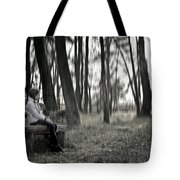 Girl Sitting On A Wooden Bench In The Forest Against The Light Tote Bag by Joana Kruse