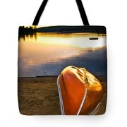 Lake Sunset With Canoe On Beach Tote Bag by Elena Elisseeva