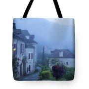 Misty Dawn In Saint Cirq Lapopie Tote Bag by Brian Jannsen
