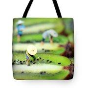 Planting rice on kiwifruit Tote Bag by Paul Ge