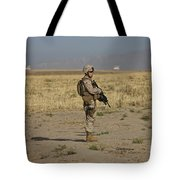 U.s. Marine Patrols A Wadi Near Kunduz Tote Bag by Terry Moore