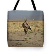 U.s. Marine Patrols A Wadi Near Kunduz Tote Bag by Terry Moore
