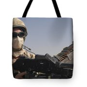 A British Army Soldier Mans A Machine Tote Bag by Andrew Chittock