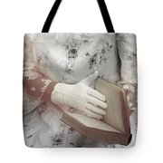 Woman With A Book Tote Bag by Joana Kruse