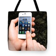 Hands Holding An Iphone Tote Bag by Photo Researchers, Inc.