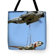 A Ch-53 Sea Stallion Lifts A Hu-25 Tote Bag by Stocktrek Images