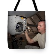 A Crew Chief Works On Mq-1 Predators Tote Bag by HIGH-G Productions
