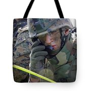 A Marine Communicates Over The Radio Tote Bag by Stocktrek Images