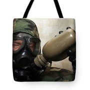 A Marine Drinks Water From A Canteen Tote Bag by Stocktrek Images
