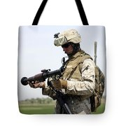 A Marine Looks At A Brand New Tote Bag by Stocktrek Images