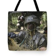 A Marine Splashes As He Makes His Way Tote Bag by Stocktrek Images