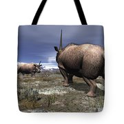 A Pair Of Male Elasmotherium Confront Tote Bag by Walter Myers