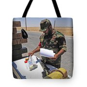 A Rebel Collects His Food Ration Tote Bag by Andrew Chittock